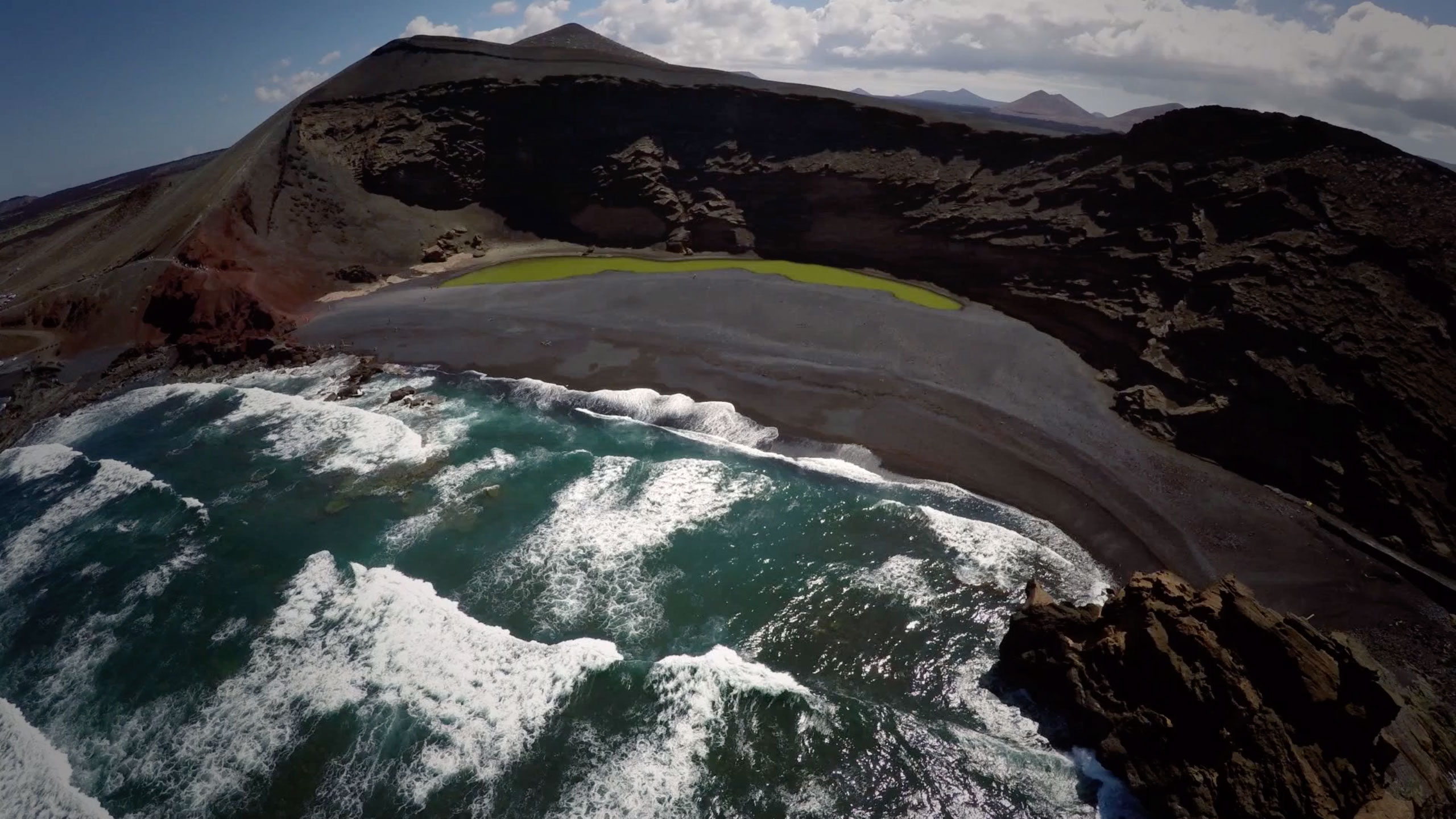 Stunning image of the waves crashing near the black volcanic rock on Lanzarote Island