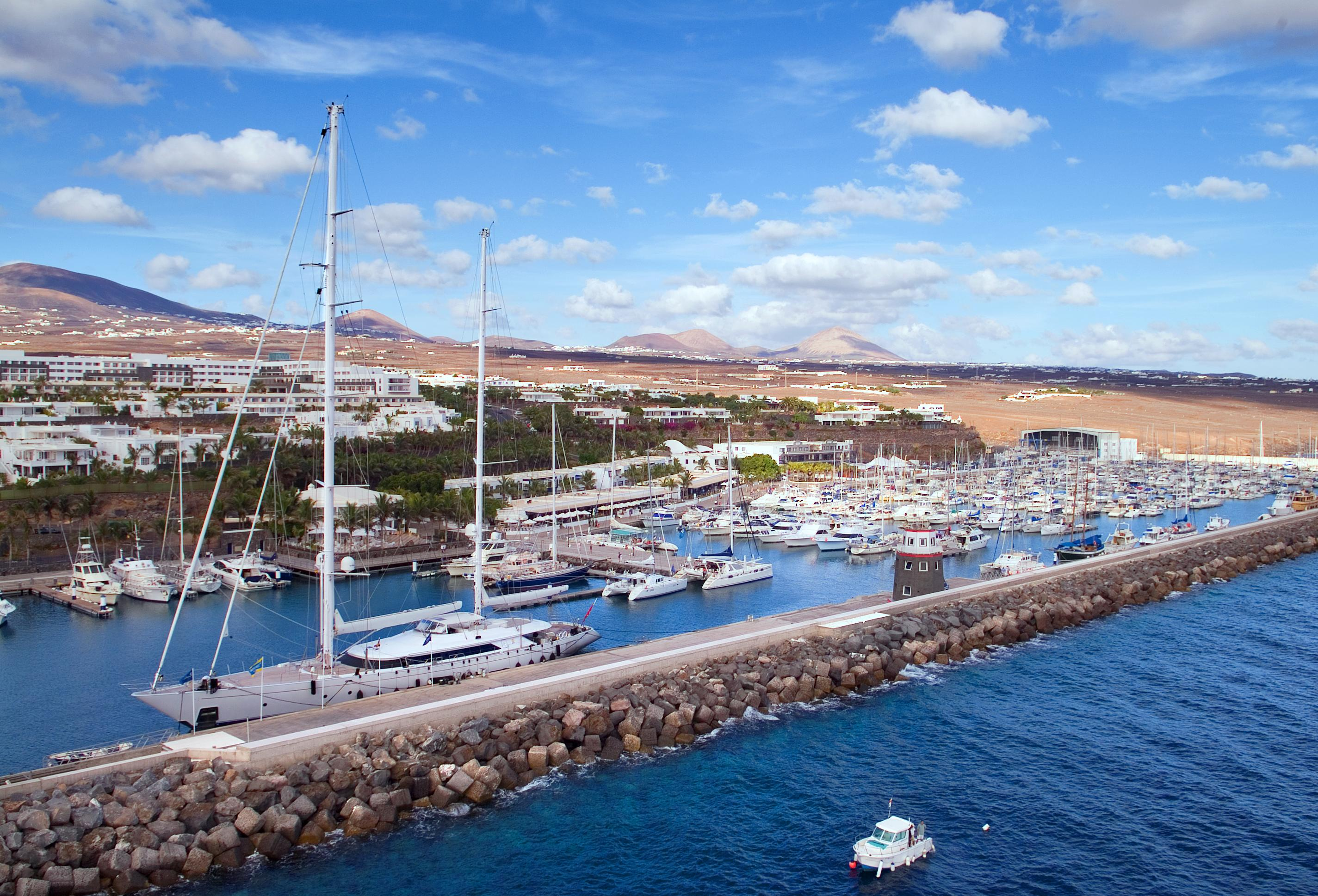 A view of the city and the mountains of Lanzarote from the marina at Puerto Calero.