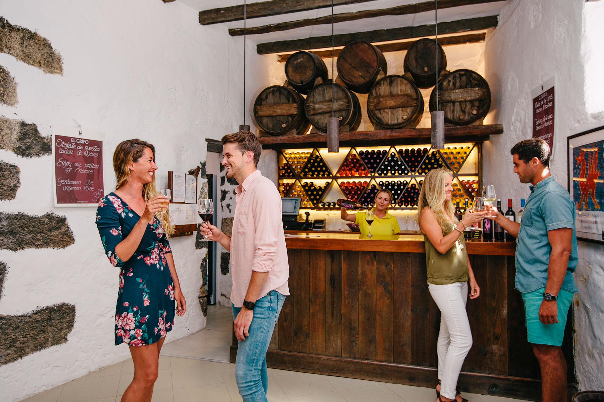 Several young people trying the wine in the wine room at Vino Cata.