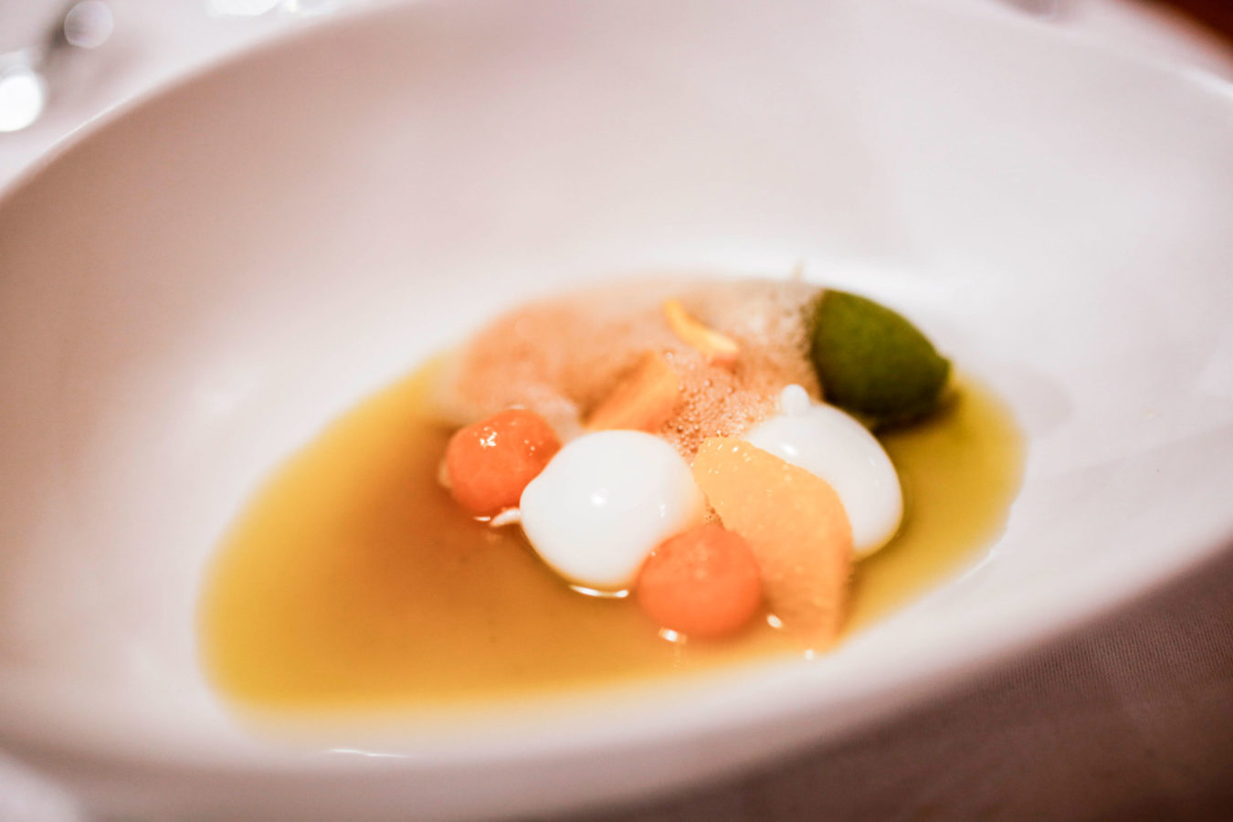 Cheese, melon, and citrus dish prepared by the extraordinary chefs at Finca km0