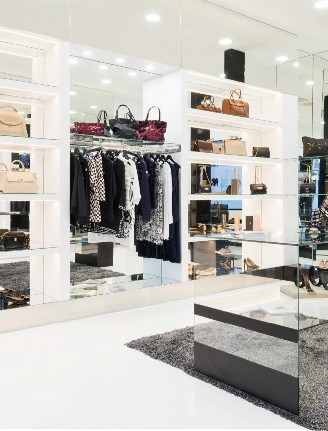 Purses, clothing, and accessories for sale at a high-end boutique store.