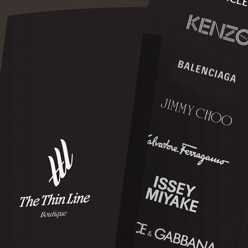 Black paper with white logos of brands sold at The Thin Line Shopping Center